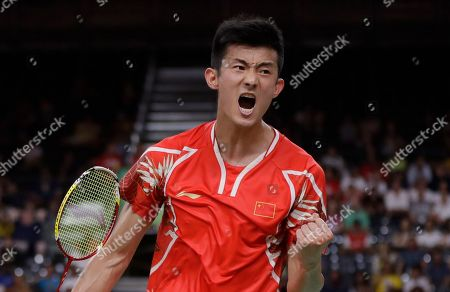 Chan Peng Soon, Goh Liu Ying Chen Long, of China, celebrates after winning a point against Son Wan Ho, of South Korea, during a men's singles quarterfinal badminton match at the 2016 Summer Olympics in Rio de Janeiro, Brazil