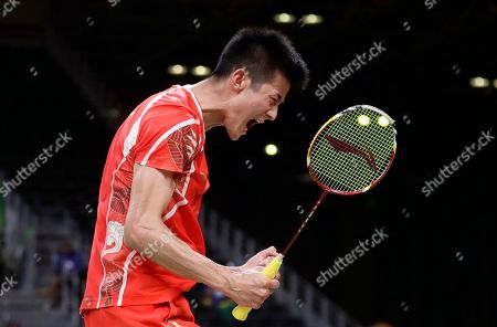 Stock Photo of Chan Peng Soon, Goh Liu Ying Chen Long, of China, celebrates after winning a point against Son Wan Ho, of South Korea, during a men's singles quarterfinal badminton match at the 2016 Summer Olympics in Rio de Janeiro, Brazil