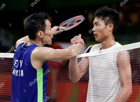 Lee Chong Wei, of Malaysia, left, shakes hands with Chou Tien Chen, of Taiwan, after Lee won their men's singles quarterfinal badminton match at the 2016 Summer Olympics in Rio de Janeiro, Brazil