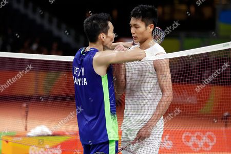 Stock Photo of Lee Chong Wei, of Malaysia, left, talks with Chou Tien Chen, of Taiwan, right, after Lee won their men's singles quarterfinal badminton match at the 2016 Summer Olympics in Rio de Janeiro, Brazil