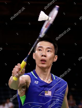 Stock Picture of Lee Chong Wei, of Malaysia, returns a shot to Chou Tien Chen, of Taiwan, during a men's singles quarterfinal badminton match at the 2016 Summer Olympics in Rio de Janeiro, Brazil