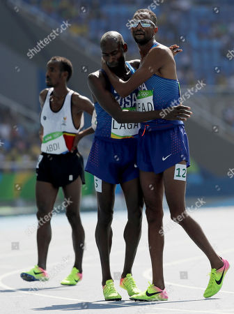 United States' Hassan Mead, right, and United States' Bernard Lagat after competing in a men's 5000-meter heat during the athletics competitions of the 2016 Summer Olympics at the Olympic stadium in Rio de Janeiro, Brazil