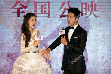 """Stock Image of Angelbaby, Jing Boran Hong Kong actress Angelababy and Chinese actor Jing Boran laugh during a press conference for the Chinese movie """"Love O2O"""" in Beijing, . The romance film opens in China on Aug. 12"""