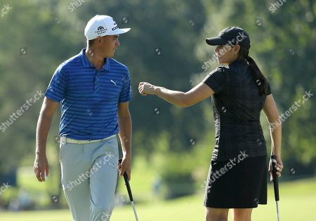 Mia Hamm, Rickie Fowler Soccer star Mia Hamm, right, jokes with Rickie Fowler, left, on the ninth green during the pro-am for the Wyndham Championship golf tournament in Greensboro, N.C
