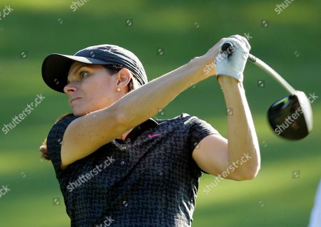 Mia Hamm Soccer star Mia Hamm watches her tee shot on the ninth hole during the pro-am for the Wyndham Championship golf tournament in Greensboro, N.C