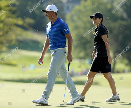 Rickie Fowler, Mia Hamm Rickie Fowler, left, and Mia Hamm, right, share a laugh on the ninth green during the pro-am for the Wyndham Championship golf tournament in Greensboro, N.C