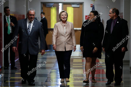Hillary Clinton, David Quolke, Alexis Haney, Eric Gordon Democratic presidential candidate Hillary Clinton arrives to tours John Marshall High School in Cleveland, before participating in a campaign event. With Clinton, from left are, David Quolke, President, Cleveland Teachers Union, student Alexis Haney, and Eric Gordon Chief Executive Officer, Cleveland Metropolitan School District