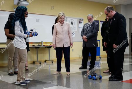 Hillary Clinton, Eric Gordon, David Quolke, Alexis Haney Democratic presidential candidate Hillary Clinton is shown robots by student, left, as she tours classrooms at John Marshall High School in Cleveland, before participating in a campaign event. Stand with Clinton are David Quolke, President, Cleveland Teachers Union, Third from right, student Alexis Haney, second from right and and Eric Gordon Chief Executive Officer, Cleveland Metropolitan School District, right