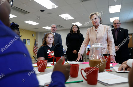 Hillary Clinton, David Quolke, Eric Gordon Democratic presidential candidate Hillary Clinton talks with students as she tours classrooms at John Marshall High School in Cleveland, before participating in a campaign event. AP Photo/Carolyn Kaster