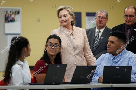 Hillary Clinton, David Quolke, Eric Gordon Democratic presidential candidate Hillary Clinton talks with students as she tours classrooms at John Marshall High School in Cleveland, before participating in a campaign event. Stands behind Clinton at right is Eric Gordon Chief Executive Officer, Cleveland Metropolitan School District, and David Quolke, President, Cleveland Teachers Union, second from right