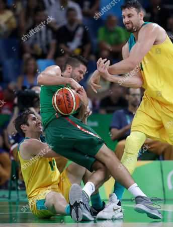 Lithuania's Mantas Kalnietis, center, is stripped of the ball by Australia's Andrew Bogut, right, as he tries to score over Damian Martin (15) during a men's quarterfinal round basketball game at the 2016 Summer Olympics in Rio de Janeiro, Brazil