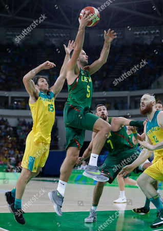 Lithuania's Mantas Kalnietis (5) drives to the basket past Australia's Damian Martin (15) and over Aron Baynes (12) during a men's quarterfinal round basketball game at the 2016 Summer Olympics in Rio de Janeiro, Brazil