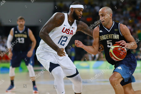 Demarcus Cousins of United States against Manu Ginobili of Argentina during quarterfinal round Men's Basketball at Rio 2016 Olympic Games at the Arena Carioca 1 in Rio de Janeiro, Brazil, Wednesday, Aug. 16, 2016