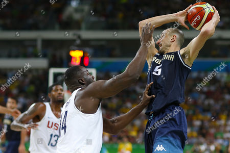 Draymond Green of United States against Manu Ginobili of Argentina during quarterfinal round Men's Basketball at Rio 2016 Olympic Games at the Arena Carioca 1 in Rio de Janeiro, Brazil, Wednesday, Aug. 16, 2016