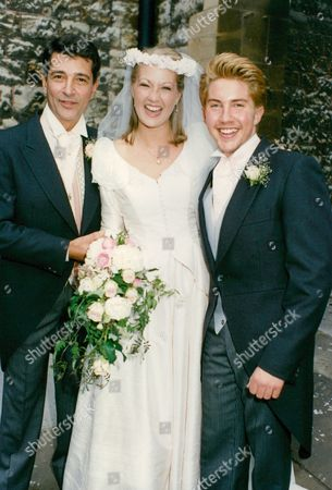 Editorial photo of Wedding Of Actors Tony Anholt And Tracey Childs. The Happy Couple With Best Man Tony's Son Christien Anholt. Box 688 12605165 A.jpg.