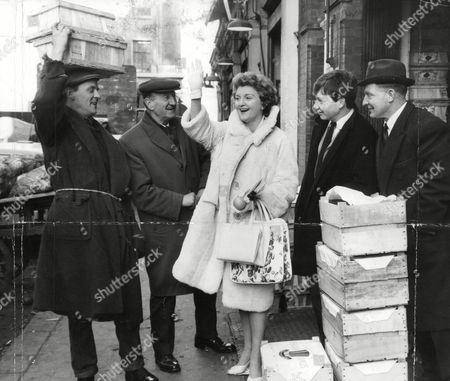 Stock Picture of Actress Avril Angers Saying Goodbye To Four Friends Who Work Near Her Home At Covent Garden Market. She Is Bound For The Airport For A Flight To Rome. L-r: Tom Brown Albert Such Andrew Springer And George Gibson. Box 688 426051639 A.jpg.