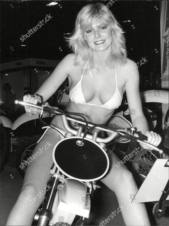 Glamour Model Janine Andrews Sitting Astride A Suzuki Motorcycle At The International Motor Cycle Show At Earls Court London Box 688 726051639 A.jpg.
