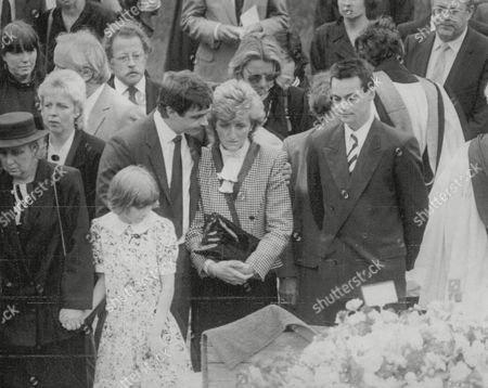 Funeral Of Television Presenter Russell Harty. Harty's Sister Sandra Barnes Is Comforted By A Male Mourner; Novelist Jamie Mcneill Close Friend Of Harty Is On Her Right. Box 691 1008061612 A.jpg.
