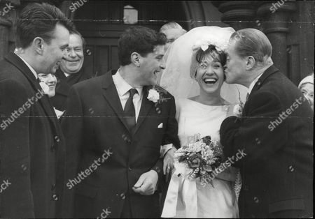 Actors Robert Arnold And Zeph Gladstone Filming A Marriage Scene For The Tv Programme: Dixon Of Dock Green. Jack Warner (right) Who Plays George Dixon Kissing The Bride And Peter Byrne (left) Who Plays Det. Sgt. Andy Crawford. Box 692 609061620 A.jpg.
