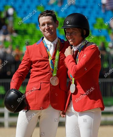 United States' Mclain Ward, left, and Elizabeth Madden celebrate after winning a silver medal in the equestrian team jumping competition at the 2016 Summer Olympics in Rio de Janeiro, Brazil
