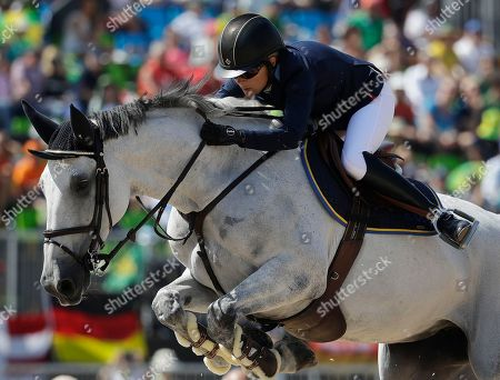 Sweden's Malin Baryard-Johnsson, riding Cue Channa, competes in the equestrian jumping competition at the 2016 Summer Olympics in Rio de Janeiro, Brazil