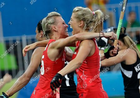 Britain's Alex Danson, left, celebrates her goal with her teammate Georgie Twigg, right, against New Zealand during a women's field hockey semifinal match at 2016 Summer Olympics in Rio de Janeiro, Brazil