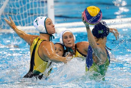 Brazil's Izabella Chiappini passes the ball forward as Australia's Rowie Webster goes to block during their women's classification 5th-8th place water polo match at the 2016 Summer Olympics in Rio de Janeiro, Brazil