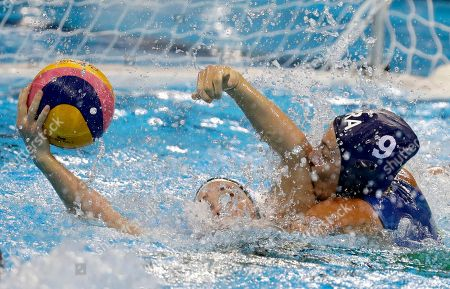 Stock Picture of Australia's Nicola Zagame, left, and Brazil's Camila Pedrosa during their women's classification 5th-8th place water polo match at the 2016 Summer Olympics in Rio de Janeiro, Brazil