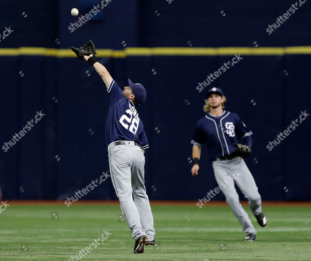 Nick Noonan, Travis Jankowski San Diego Padres second baseman Nick Noonan (28) makes a running catch on a pop fly ball by Tampa Bay Rays' Evan Longoria during the first inning of an interleague baseball game, in St. Petersburg, Fla. Backing up the play is center fielder Travis Jankowski