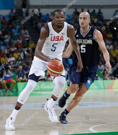 United States' Kevin Durant, left, drives around Argentina's Manu Ginobili, right, during a men's quarterfinal round basketball game at the 2016 Summer Olympics in Rio de Janeiro, Brazil