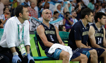 Argentina's Manu Ginobili (5) sits on the bench during the final moments of the team's loss to the United States a men's quarterfinal round basketball game at the 2016 Summer Olympics in Rio de Janeiro, Brazil