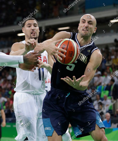 Argentina's Manu Ginobili (5) grabs a rebound in front of United States' Klay Thompson (11) during a men's quarterfinal round basketball game at the 2016 Summer Olympics in Rio de Janeiro, Brazil
