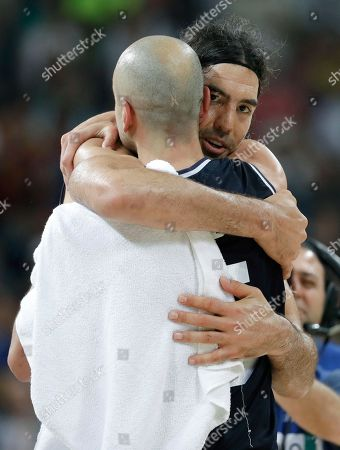 Argentina's Manu Ginobili, left, gets a hug from teammate Luis Scola, right, after a quarterfinal round basketball game against the United States at the 2016 Summer Olympics in Rio de Janeiro, Brazil