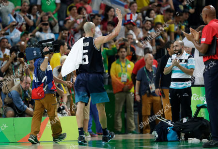 Argentina's Manu Ginobili (5) waves to fans as he leaves the court after a quarterfinal round basketball game against the United States at the 2016 Summer Olympics in Rio de Janeiro, Brazil