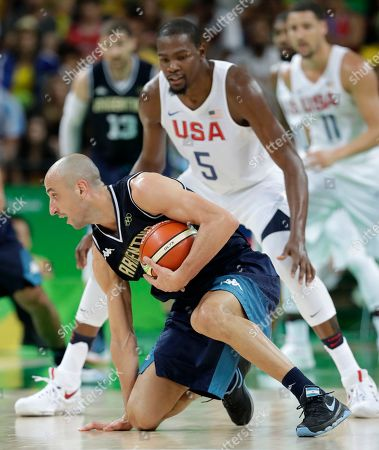 Argentina's Manu Ginobili picks up a loose ball in front of United States' Kevin Durant (5) during a quarterfinal round basketball game at the 2016 Summer Olympics in Rio de Janeiro, Brazil