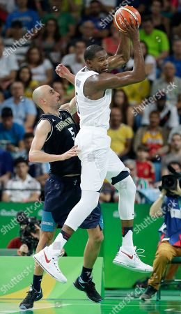 United States' Kevin Durant, right, grabs a rebound over Argentina's Manu Ginobili, left, during a quarterfinal round basketball game at the 2016 Summer Olympics in Rio de Janeiro, Brazil