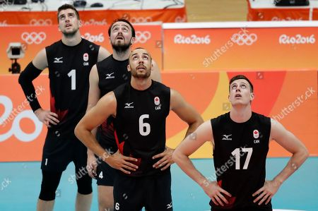 Canada's Tyler Sanders, left, Nicholas Hoag, Justin Duff and Graham Vigrass look up at a replay that did not go in their favor in a men's quarterfinal volleyball match against Russia at the 2016 Summer Olympics in Rio de Janeiro, Brazil