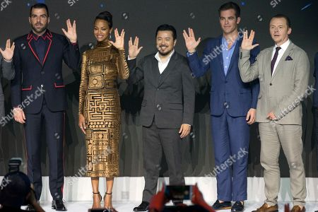 Zachary Quinto, Zoe Saldana, Justin Lin, Chris Pine, Simon Pegg From left actor Zachary Quinto, actress Zoe Saldana, director Justin Lin, lead actor Chris Pine and British actor Simon Pegg hold up a hand gesture from the movie during a press conference for Star Trek Beyond, the latest in the popular sci-fi franchise held in Beijing