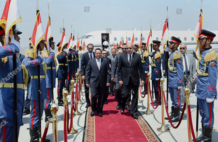 Egyptian Prime Minister Sherif Ismail welcomes Yemen's Prime Minister Ahmed Obeid bin Daghr upon his arrival at Cairo's international airport