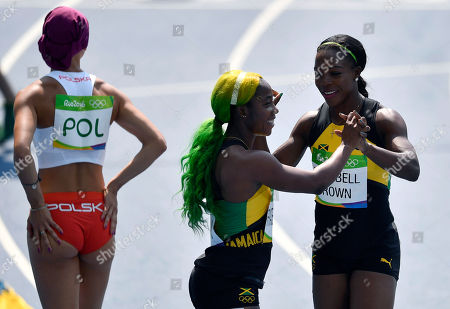 Jamaica's Veronica Campbell-Brown, right, and Jamaica's Shelly-Ann Fraser-Pryce wins a women's 4x100-meter relay heat during the athletics competitions of the 2016 Summer Olympics at the Olympic stadium in Rio de Janeiro, Brazil