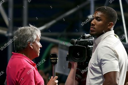 Boxing - John Inverdale interviews Anthony Joshua, the current IBF heavyweight champion, during the semi-final of the Women's Fly 51 kg category featuring Nicola Adams of Team GB and Ren Cancan of China during day thirteen of the Rio Olympics 2016 on the 18th August 2016