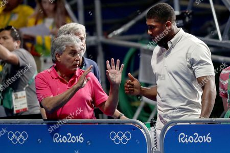Boxing - John Inverdale watches with Anthony Joshua, the current IBF heavyweight champion, the semi-final of the Women's Fly 51 kg category featuring Nicola Adams of Team GB and Ren Cancan of China during day thirteen of the Rio Olympics 2016 on the 18th August 2016