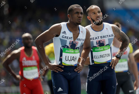 Britain's Chijindu Ujah, left, and James Ellington after competing in a men's 4x100-meter relay heat during the athletics competitions of the 2016 Summer Olympics at the Olympic stadium in Rio de Janeiro, Brazil
