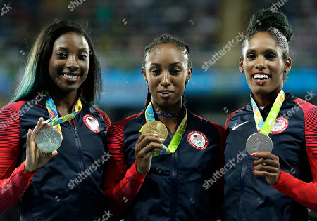 Gold medal winner Brianna Rollins is flanked by silver medal winner Nia Ali, left, and bronze medal winner Kristi Castlin, all from the United States, during the medal ceremony for the women's 100-meter hurdles at the athletics competitions of the 2016 Summer Olympics at the Olympic stadium in Rio de Janeiro, Brazil