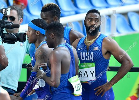 United States' Tyson Gay, right, after competing in a men's 4x100-meter relay heat during the athletics competitions of the 2016 Summer Olympics at the Olympic stadium in Rio de Janeiro, Brazil