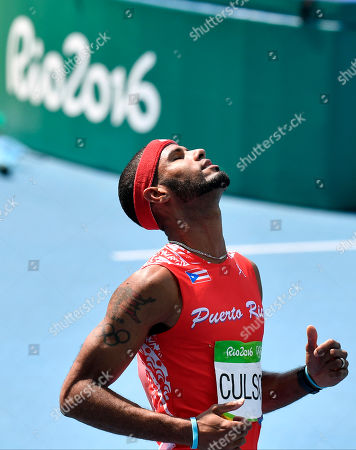 Puerto Rico's Javier Culson after being disqualified in the men's 400-meter hurdles final during the athletics competitions of the 2016 Summer Olympics at the Olympic stadium in Rio de Janeiro, Brazil