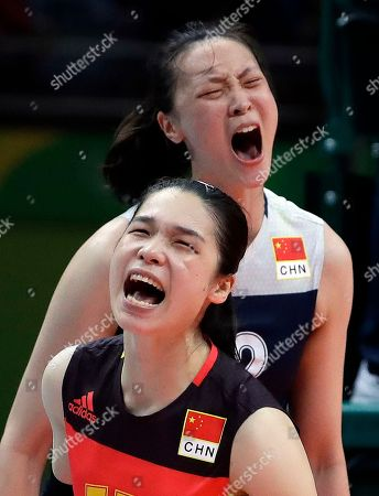China's Lin Li, bottom, and Hui Ruoqi celebrate during a women's semifinal volleyball match against the Netherlands at the 2016 Summer Olympics in Rio de Janeiro, Brazil