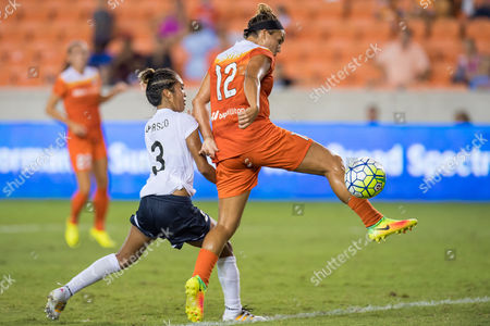 Houston Dash midfielder Amber Brooks (12) attempts to redirect the ball into the goal while being guarded by Washington Spirit defender Caprice Dydasco (3) during the 2nd half