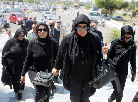 Sisters of Egyptian-American Nobel Laureate Ahmed Zewail arrive at Cairo International Airport to receive the body of their brother, in Cairo, Egypt
