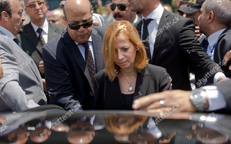 Dema Faham, the widow of Egyptian-American Nobel Laureate Ahmed Zewail, arrives with the body of her husband from the United States, at Cairo International Airport in Cairo, Egypt